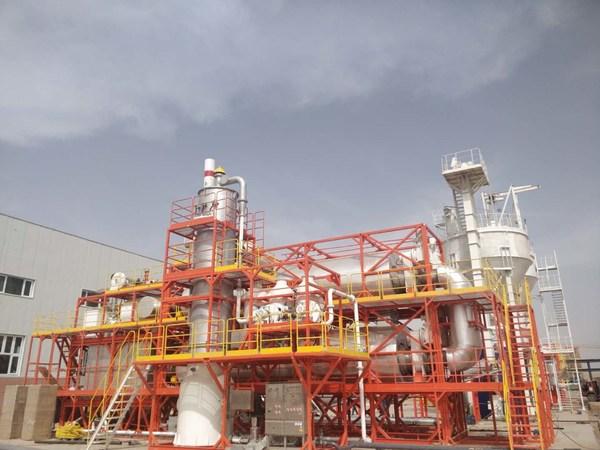 杰瑞环保连续双层双螺旋式热相分离成套技术设备进行油泥处理