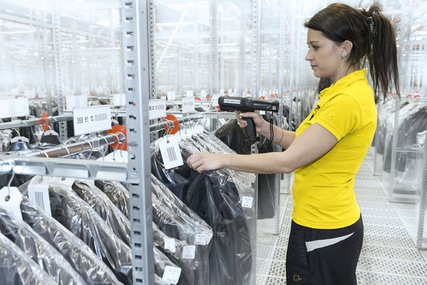 In a person-to-goods wave pick, an operator typically receives a group of orders and walks a circuit to pick all items for those orders.