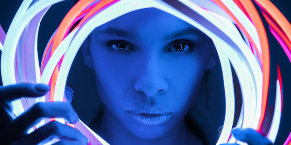 portrait of futuristic african american woman in neon lighting