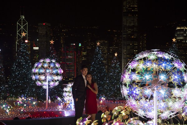 """Visitors enjoy """"Christmas Lighting & Music Show"""" with the amazing skyline as a backdrop in Harbour City, Hong Kong."""