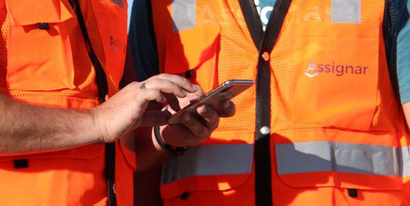 Crews using the Assignar fieldworker app on a job site.