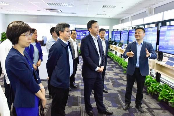 上海市政府副秘书长陈鸣波带队赴中电金信考察调研
