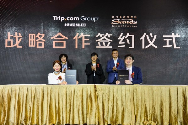 Jane Sun, CEO, Trip.com Group (left), and Grant Chum, COO, Sands China Ltd. (right), sign a strategic partnership agreement during the event, with Maria Helena de Senna Fernandes, Director, Macao Government Tourism Office (centre) overseeing