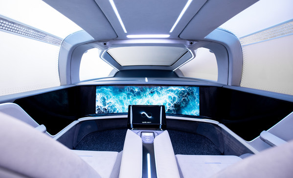 Interior of Baidu's robocar, featuring an intelligent display, control pad and no steering wheel or pedals