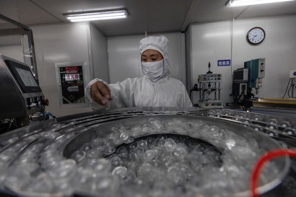 A woman works in a Suyun factory for medical supplies.
